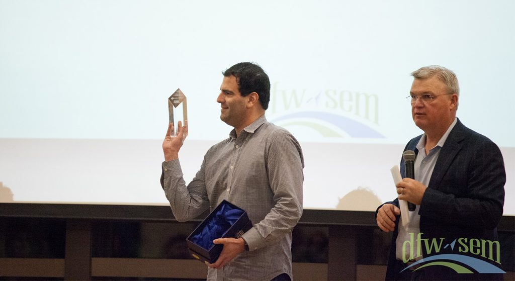 James Loomstein shows off his DFWSEM President's Award trophy.